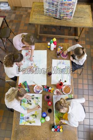 art teacher guiding middle school students