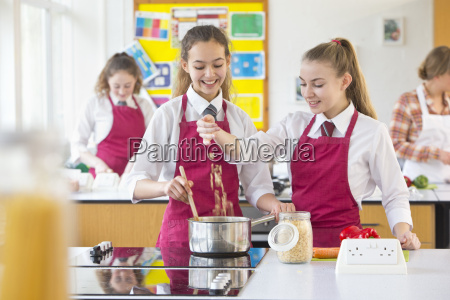 high school students cooking pasta in