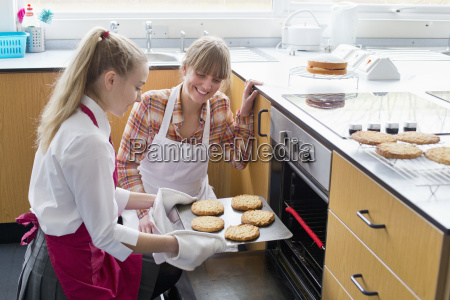 teacher teaching high school student removing