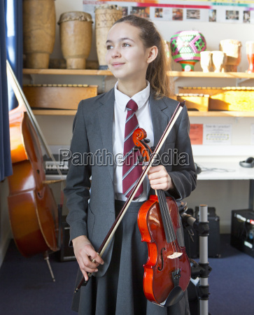 proud high school student with violin