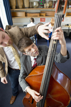 music teacher guiding middle school student