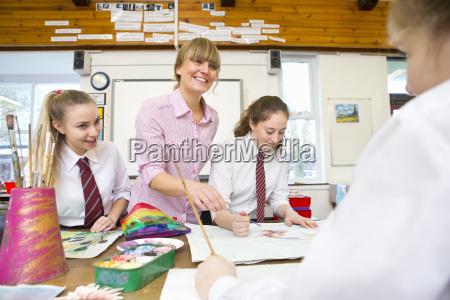 smiling art teacher teaching middle school