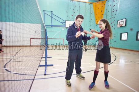 gym teacher teaching high school student