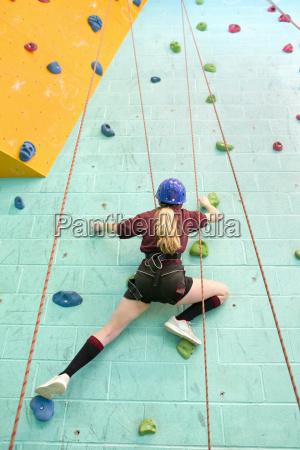 high school student climbing rock climbing