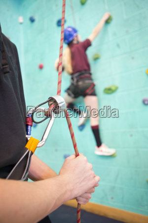 high school student holding rope supporting