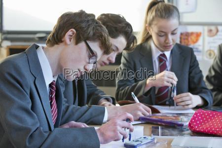 high school student doing math homework