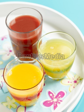 three glasses of juice on a