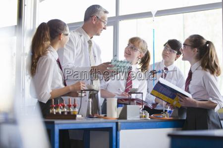 chemistry teacher teaching high school students