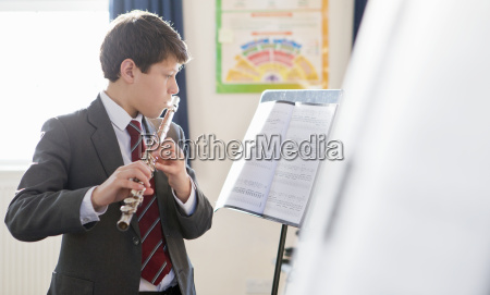 high school student playing clarinet in