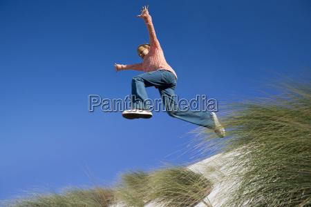 exuberant girl jumping for joy over