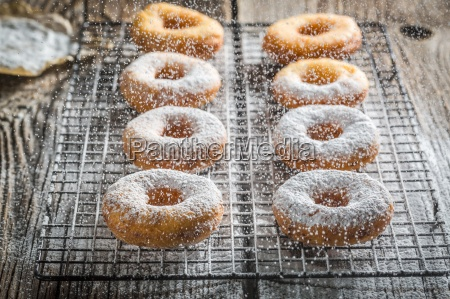 freshly baked doughnuts dusted with icing