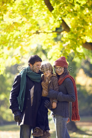 family in park in autumn