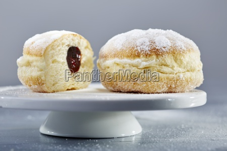 doughnuts with icing sugar and ham