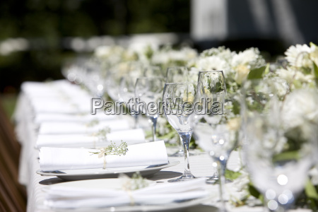row of place settings on table
