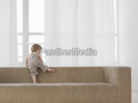 a little boy climbing over the
