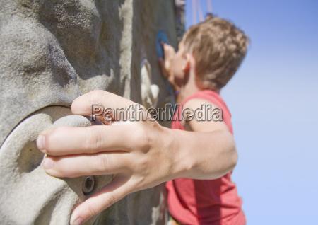 a young boy scaling a climbing