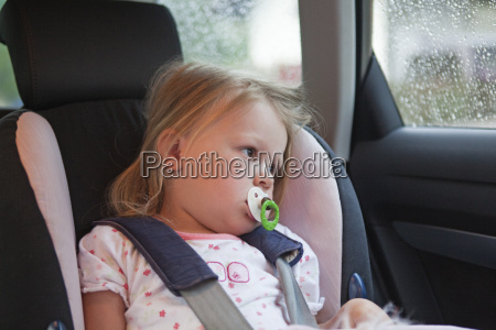 young baby girl in car seat