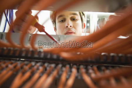 close up of young electrician working