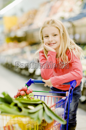 portrait of young girl in grocery