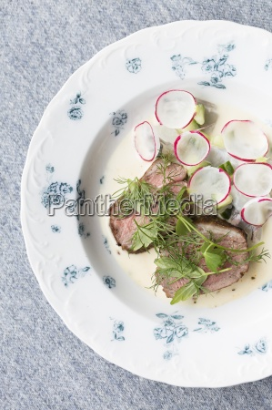 fried duck breast with fresh herbs