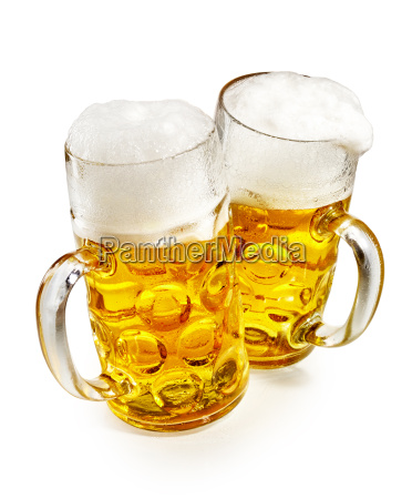 two pint mugs of frothy cold