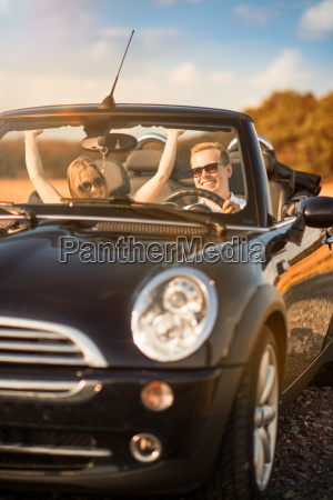 amorous couple in the car is