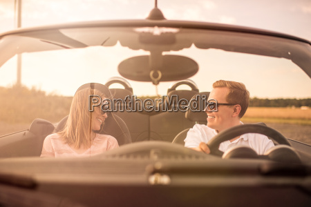 young loving couple in a convertible