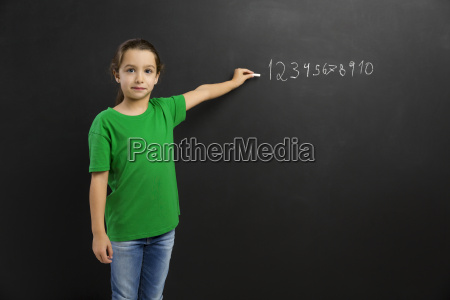 girl writing in a blackboard