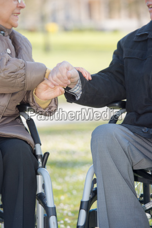 closeup of hands of elderly couple