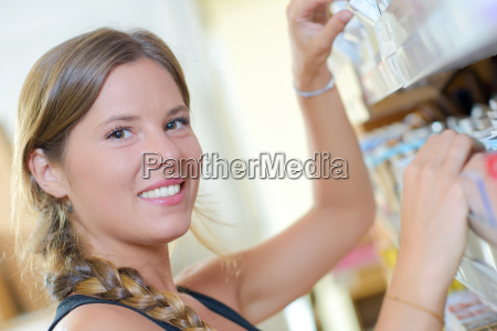 girl working in cigarette shop