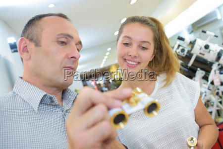 man showing opera glasses to young