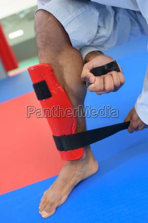 martial artist putting on a leg