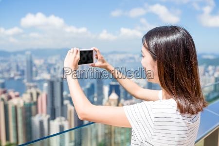 young woman taking photo of hong