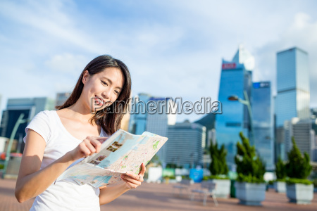 woman searching the location on city