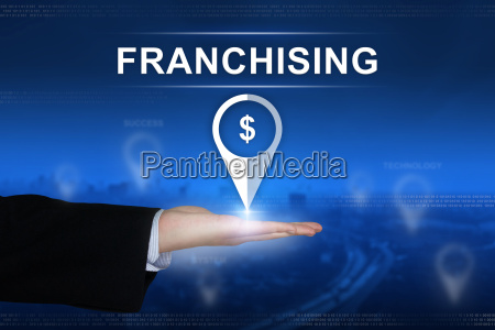 franchising button on blurred background