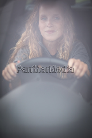 pretty young woman driving her new