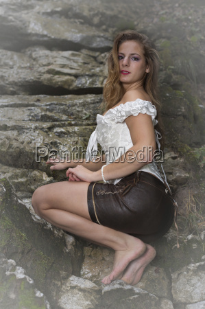 young woman on rock plate