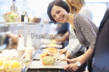 portrait of businesswoman in lunch line
