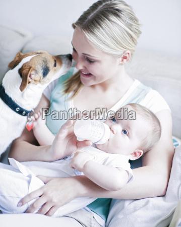 teenage girl feeding baby boy