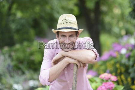 man smiling in garden