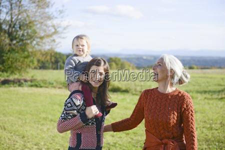 multigenerational family having fun in field