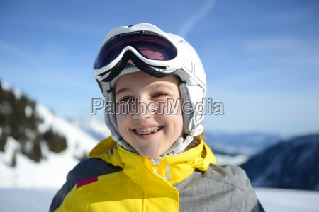 teenage girl smiling on skiing holiday