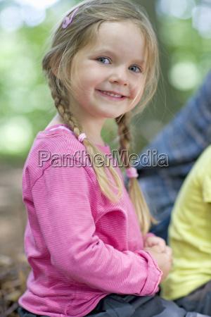 kindergarten child smiling in a wood