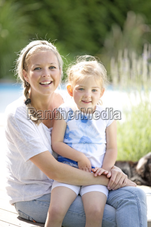 mother and girl sitting together portrait