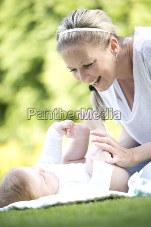 mother laughing with baby boy in