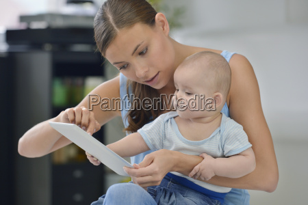 baby boy touching digital tablet with