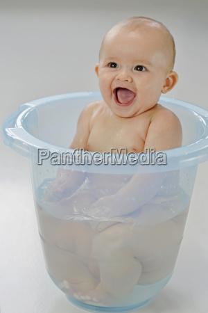 baby boy in blue baby bath