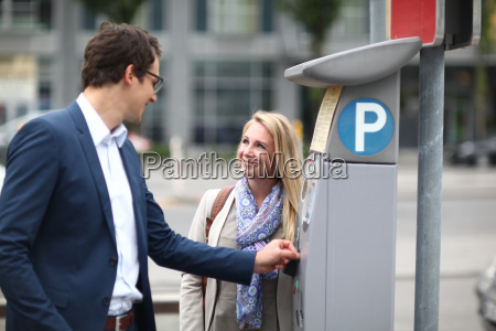 mid adult couple at parking meter
