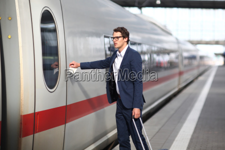mid adult business man reaching for