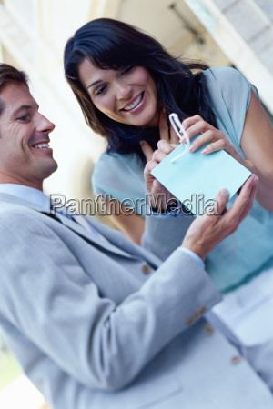young woman accepting gift from man